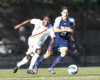 Boston College midfielder Derrick Boateng (7) on the attack. Boston College defeated University of Rhode Island, 4-2, at Newton Campus Field, September 25, 2012.