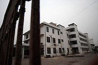 A deserted factory in Houjie Town, Donguan, China.  Many of the factories closed leaving workers unpaid. the workers dstroyed some factories.  As the economy changes and Chinese labour gets more expensive, factories are cosing leaving ghost towns behind them.<br /> <br /> MUST CREDIT PHOTO BY RICHARD JONES/SINOPIX