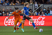 SAN JOSE, CA - JULY 24: Zarek Valentin #4 of the Houston Dynamo challenges Florian Jungwirth #23 of the San Jose Earthquakes during a game between San Jose Earthquakes and Houston Dynamo at PayPal Park on July 24, 2021 in San Jose, California.