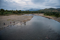 Haiti, Gros-Morne. People washing at the river.