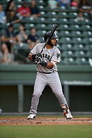 Catcher Jeffry Parra (26) of the Augusta GreenJackets bats in a game against the Greenville Drive on Wednesday, April 10, 2019, at Fluor Field at the West End in Greenville, South Carolina. Augusta won, 9-8. (Tom Priddy/Four Seam Images)