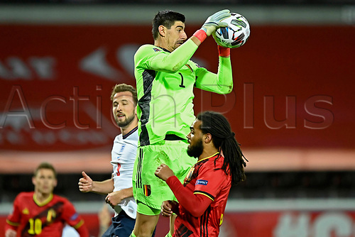 15th November 2020; Leuven, Belgium;  Thibaut Courtois goalkeeper of Belgium jumps higher than Harry Kane forward of England during the UEFA Nations League match group stage final tournament - League A - Group 2 between Belgium and England