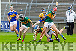 Kerry's Liam Palmer races for possession as team mate Charlie Keating holds up the Tipperary defence in the Munster Minor Hurling Championship