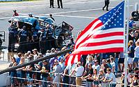 Aug 18, 2019; Brainerd, MN, USA; An American flag waves next the car of NHRA funny car driver Shawn Langdon during the Lucas Oil Nationals at Brainerd International Raceway. Mandatory Credit: Mark J. Rebilas-USA TODAY Sports