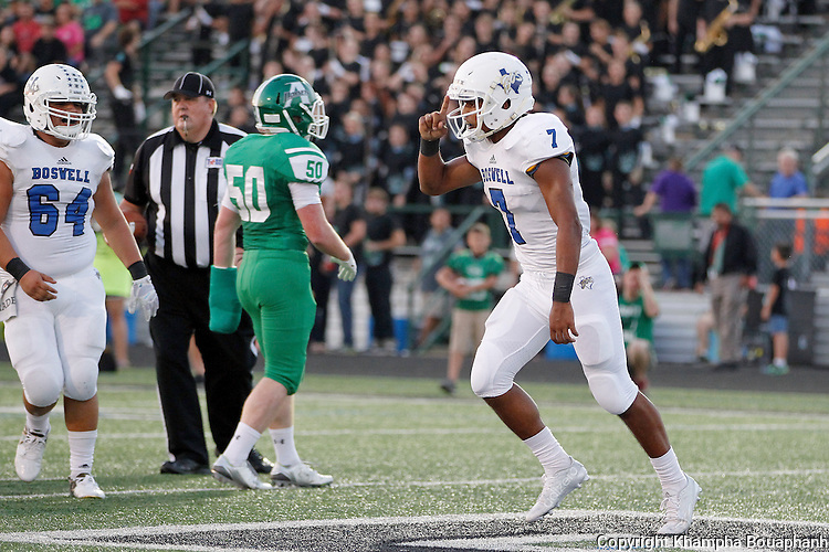 Boswell senior quarterbadk Anthony Ramirez celebrates his 8-yard touchdown run in the frist quarter against Azle in district 5-5A high school football at Azle on Friday, September 25, 2015. Azle won 34-24. (photo by Khampha Bouaphanh)