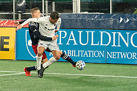 FOXBOROUGH, MA - NOVEMBER 1: Adam Buksa #9 of New England Revolution tries to keep the ball from crossing the goal line at the Revolution goal during a game between D.C. United and New England Revolution at Gillette Stadium on November 1, 2020 in Foxborough, Massachusetts.