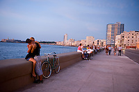Lovers kissing at the Malecon