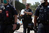 Police return water to demonstrators near the White House after a perimeter pushed them back in Washington D.C., U.S., on Tuesday, June 23, 2020.  Trump tweeted that he authorized the Federal government to arrest any demonstrator caught vandalizing U.S. monuments, with a punishment of up to 10 years in prison.  Credit: Stefani Reynolds / CNP/AdMedia