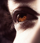 Closeup of woman brown eye in sunlight Image © MaximImages, License at https://www.maximimages.com