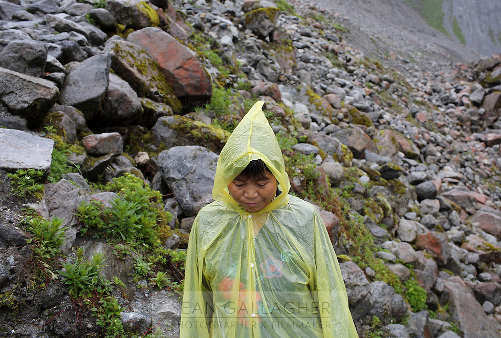 A tourist walking near the Hailuogou glacier in western Sichuan Province, China. As a result of rising temperatures on the Tibetan Plateau, the Hailuogou glacier has retreated over 2 km during the 20th century alone. Since the Little Ice Age, studies have revealed that the total monsoonal glacier coverage in the southeast of the Tibetan Plateau has decreased by as much as 30 percent, causing alarm in scientific circles.