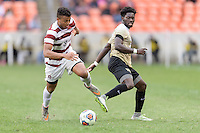 Houston, TX - Friday December 11, 2016: Brian Nana-Sinkam (8) of the Stanford Cardinal brings the ball up the field with Ema Twumasi (22) of the Wake Forest Demon Deacons in pursuit at the NCAA Men's Soccer Finals at BBVA Compass Stadium in Houston Texas.