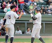 Infielder Dante Bichette Jr. (19) of the Charleston RiverDogs, right, is congratulated by Robert Refsnyder (15) after hitting his first home run of the season in a game against the Greenville Drive on Sunday, April 7, 2013, at Fluor Field at the West End in Greenville, South Carolina. Charleston won, 5-0. Bichette Jr. is the No. 21 prospect for the New York Yankees, according to Baseball America.(Tom Priddy/Four Seam Images)