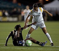 Formiga (left) struggles to keep the ball away from Marta (10). LA Sol and FC Gold Pride tied 0-0 at Buck Shaw Stadium in Santa Clara, California on July 23, 2009.