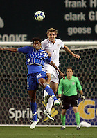Chad Marshall #4 of the USA beats Carlos Costly #13 of Honduras to a header during a CONCACAF Gold Cup match at RFK Stadium on July 8 2009 in Washington D.C USA won 2-0.