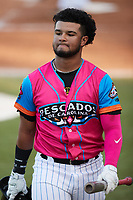 Hedbert Perez (6) of the Pescados de Carolina walks back to the dugout during the game against the Delmarva Shorebirds at Five County Stadium on September 4, 2021 in Zebulon, North Carolina. (Brian Westerholt/Four Seam Images)