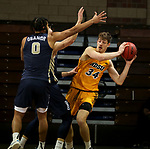 SIOUX FALLS, SD - MARCH 9: Rocky Kreuser #34 of the North Dakota State Bison looks for help out of a double team including Kevin Obanor #0 of the Oral Roberts Golden Eagles during the 2021 Men's Summit League Basketball Championship at the Sanford Pentagon in Sioux Falls, SD. (Photo by Dave Eggen/Inertia)