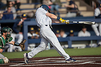 Michigan Wolverines first baseman Jimmy Kerr (15) swings the bat during the NCAA baseball game against the Eastern Michigan Eagles on May 8, 2019 at Ray Fisher Stadium in Ann Arbor, Michigan. Michigan defeated Eastern Michigan 10-1. (Andrew Woolley/Four Seam Images)