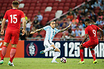 Leandro Paredes of Argentina (L) fights for the ball with Faritz Hameed of Singapore (R) during the International Test match between Argentina and Singapore at National Stadium on June 13, 2017 in Singapore. Photo by Marcio Rodrigo Machado / Power Sport Images