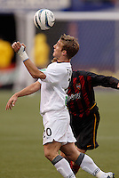 The MetroStars' Chris Leitch and New England Revolution's Taylor Twellman go for a header. The New England Revolution played the NY/NJ MetroStars to a 1 to 1 tie at Giant's Stadium, East Rutherford, NJ, on April 25, 2004.