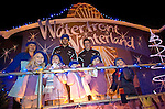 Ospreys and Wales rugby international Mike Phillips (left) catches a ride during the Christmas lights turn on parade through Swansea City Centre..