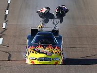 Feb 26, 2016; Chandler, AZ, USA; NHRA funny car driver Jim Campbell deploys his parachutes during qualifying for the Carquest Nationals at Wild Horse Pass Motorsports Park. Mandatory Credit: Mark J. Rebilas-