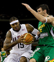 US forward (15) Carmelo Anthony drives on Lithuania center (12) Ksystofas Lavrinovicius while playing at the Cotai Arena inside the Venetian Macau Resort and Hotel.  The US defeated Lithuania, 120-84.