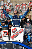 Monster Energy NASCAR Cup Series<br /> Go Bowling 400<br /> Kansas Speedway, Kansas City, KS USA<br /> Saturday 13 May 2017<br /> Martin Truex Jr, Furniture Row Racing, Auto-Owners Insurance Toyota Camry celebrates is win in Victory Lane<br /> World Copyright: Nigel Kinrade<br /> LAT Images<br /> ref: Digital Image 17KAN1nk09951