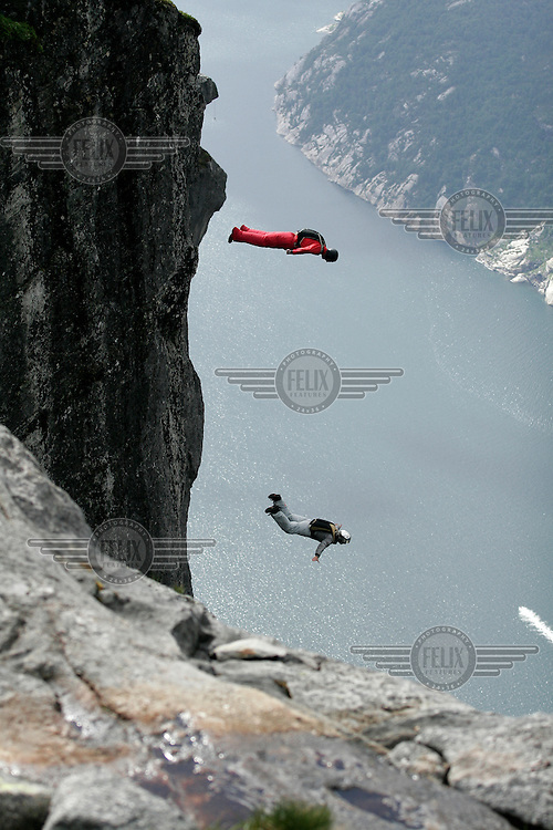 BASE jumping at Kjerag in Lysebotn during the annual Heliboogie. Approx. one hundred parachute jumpers from all over the world gather for several days of jumping from cliffs high over the Norwegian fjord of Lysefjorden. During the event helicopters bring the jumpers to the mountaintop. © Fredrik Naumann