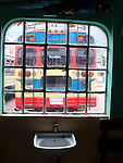 View of the back of a chicken bus through a window in Zunil, Guatemala in the Western Highlands