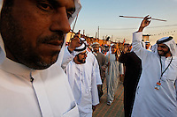 Sheik Tahnoon Bin Mohamed (Guy with glasses--Ruler of Alain) arrives at the Souk area of the camel beauty contest with his son Sheik Sultan Bin Tahnoon who is head of ADACH (Abu Dhabi Assoc. of Culture and Heritage) and ADTA Tourist Authority.
