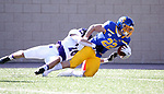 BROOKINGS, SD - APRIL 24: South Dakota State Jackrabbits running back Isaiah Davis #22 is brought down in the end zone by Holy Cross Crusaders defensive back Walter Reynolds #26 after a 60 yard touchdown at Dana J Dykhouse Stadium on April 24, 2021 in Brookings, South Dakota. (Photo by Dave Eggen/Inertia)