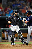 Jacksonville Jumbo Shrimp catcher Rodrigo Vigil (6) throws back to the pitcher in front of Michael Barash (16) during a game against the Mobile BayBears on April 14, 2018 at Baseball Grounds of Jacksonville in Jacksonville, Florida.  Mobile defeated Jacksonville 13-3.  (Mike Janes/Four Seam Images)