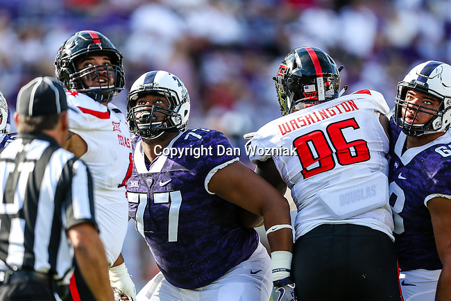 TCU Horned Frogs offensive lineman Lucas Niang (77) in action during the game between the Texas Tech Red Raiders and the TCU Horned Frogs at the Amon G. Carter Stadium in Fort Worth, Texas.