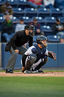 Umpire Mike Wiseman and Scranton/Wilkes-Barre RailRiders catcher Eddy Rodriguez (45) during a game against the Pawtucket Red Sox on May 15, 2017 at PNC Field in Moosic, Pennsylvania.  Scranton defeated Pawtucket 8-4.  (Mike Janes/Four Seam Images)
