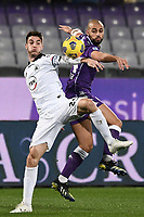 Giulio Maggiore of Spezia Calcio and Sofyan Amrabat of ACF Fiorentina compete for the ball during the Serie A football match between ACF Fiorentina and Spezia Calcio at Artemio Franchi stadium in Firenze (Italy), February 19, 2021. Photo Image Sport / Insidefoto