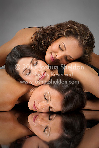 Three Hispanic womens heads stacked on each other