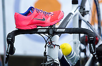 28 APR 2012 - LES SABLES D'OLONNE, FRA -  Joao Silva (Les Sables Vendee Triathlon) rests one of his running shoes on the handlebars of his bike as he prepares in transition for the prologue round of the French Grand Prix Series triathlon in Les Sables d'Olonne, France (PHOTO (C) 2012 NIGEL FARROW)