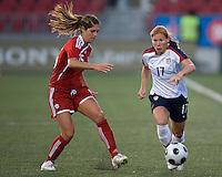 Kara Lang, Lori Chalupny. The US Women's National Team defeated the Canadian Women's National Team, 4-0, at BMO Field in Toronto during an international friendly soccer match on May 25, 2009.
