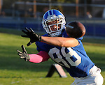 Football action. Wide receiver goes for the catch.