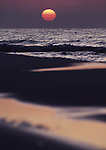 Sunset reflected on the white sandy beaches in Destin, Florida.   (Jim Bryant Photo).....