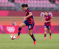 KASHIMA, JAPAN - AUGUST 5: Carli Lloyd #10 of the USWNT dribbles during a game between Australia and USWNT at Kashima Soccer Stadium on August 5, 2021 in Kashima, Japan.