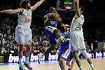 Real Madrid´s Sergio Llull and Ioannis Bourousis and Anadolu Efes´s Dontaye Draper during 2014-15 Euroleague Basketball Playoffs second match between Real Madrid and Anadolu Efes at Palacio de los Deportes stadium in Madrid, Spain. April 17, 2015. (ALTERPHOTOS/Luis Fernandez)