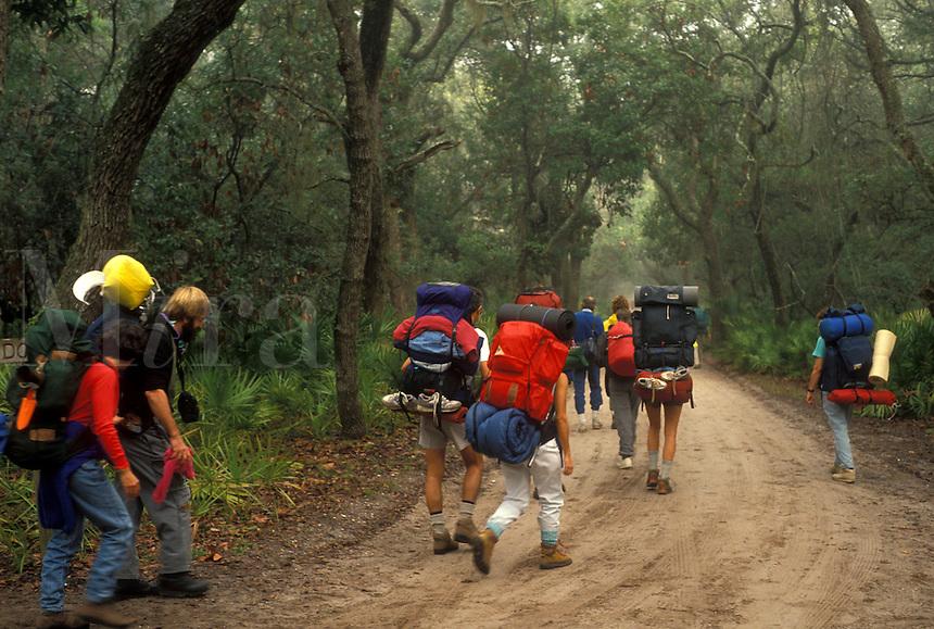 AJ2277, Cumberland Island, backpacking, hiking, Georgia, A group of backpackers walking up Grand Avenue on Cumberland Island National Seashore in Georgia.