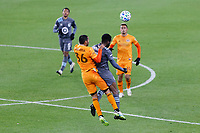 ST PAUL, MN - OCTOBER 18: Victor Cabrera #36 of Houston Dynamo and Kevin Molino #7 of Minnesota United FC battle for the ball during a game between Houston Dynamo and Minnesota United FC at Allianz Field on October 18, 2020 in St Paul, Minnesota.