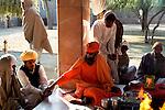 Shri visudhanand Maharaj distributes the offerings to Bishnoi people at jambeshwar temple in Jajwal near Jodhpur in Rajasthan, India.Arindam Mukherjee