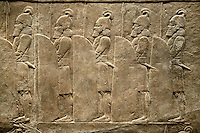 Assyrian relief sculpture panel of soldiers lining the road from the King Ashurnasirpal lion hunt.  From Nineveh  North Palace, Iraq,  668-627 B.C.  British Museum Assyrian  Archaeological exhibit no ME 120859