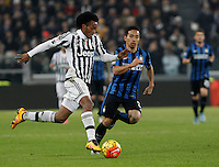 Calcio, semifinali di andata di Coppa Italia: Juventus vs Inter. Torino, Juventus Stadium, 27 gennaio 2016.<br /> Juventus' Juan Cuadrad, left, is challenged by FC Inter's Yuto Nagatomo during the Italian Cup semifinal first leg football match between Juventus and FC Inter at Juventus stadium, 27 January 2016.<br /> UPDATE IMAGES PRESS/Isabella Bonotto