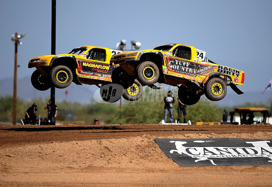 Apr 15, 2011; Surprise, AZ USA; LOORRS driver Aaron Daugherty (24) and Jerry Daugherty (23) during round 3 and 4 at Speedworld Off Road Park. Mandatory Credit: Mark J. Rebilas-.