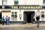 Newcastle fans find solace in the iconic Strawberry pub. Newcastle v West Ham, August 15th 2021. The first game of the season, and the first time fans were allowed into St James Park since the Coronavirus pandemic. 50,673 people watched West Ham come from behind twice to secure a 2-4 win.