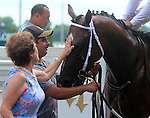 June 28, 2014:  Two year old colt Cinco Charlie (Indian Charlie x Ten Halos, by Marquetry) wins the G3 Bashford Manor Stakes at Churchill Downs with jockey Shaun Bridgmohan. He gets a pat from owner Corinne Heiligbrodt in the winner's circle. Trainer Steve Asmussen, owners Corinne and L. William Heiligbrodt. Breeder Candyland Farm.  ©Mary M. Meek/ESW/CSM
